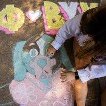 A student draws chalk art during Vol Success Week.