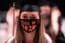 A graduate in a Class of 2020 face mask.