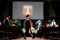 Graduate walks across Thompson-Boling Arena floor