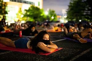 Students watches a drive-in style movie behind Natalie Haslam Music Center