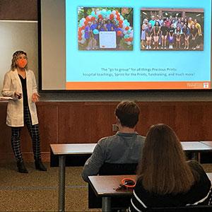 an instructor shows a Precious Prints presentation to a class