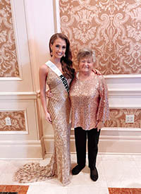 Clark, left, stands with her grandmother.