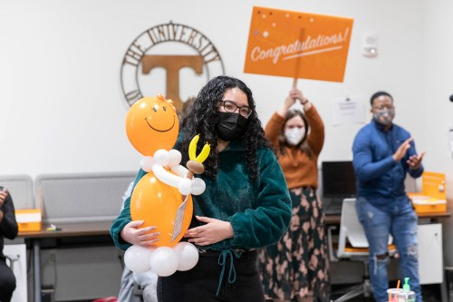 Madison Woods receives a 2021 Torchbearer award  via Zoom in the JCLS office in Student Union