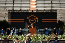 Chancellor Donde Plowman speaks at the podium.