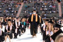 Graduates from UT's Future Program walk toward the stage at commencement.