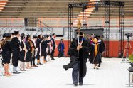 The Macebearer leads the faculty processional at commencement.