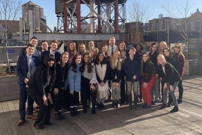 Group photo of advertising club students on a rooftop during the 2020 New York City trip.