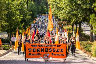 The Pride of the Southland Marching Band marches down Volunteer Blvd during their game day practice performance