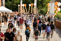 Students walk on Pedestrian Bridge for the first day of classes