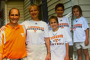 Photograph of the Youngquist family in 2009 in Tennessee shirts provided to the family. From left to right, dad David, mom Corrine, new Vol Savanna, and her siblings Daniel and Callie.
