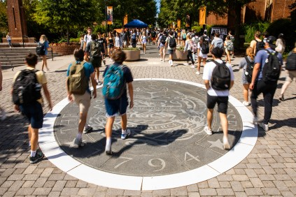 New students walk over the seal on Pedestrian Walkway.
