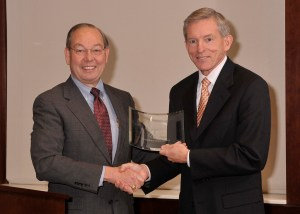 UT Knoxville Chancellor Jimmy Cheek (left) presents Clay Jones (right) with the Accomplished Alumnus Award.
