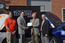 "Dennis Hopkins, Vice President of DENSO Manufacturing Tennessee, Inc. (second from right), presents the check for $50,000 to Dr. Matthew Mench (second from left) as MABE Research Assistant Professor David ""Butch"" Irick (left) and COE Dean Wayne T. Davis (right) join in expressing appreciation to the company."