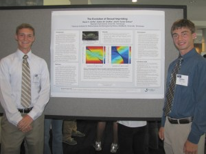 Hayes Griffin (left) and Dalton Chaffee (right) present their award-winning research at the international meeting of the Society for Mathematical Biology. Photo credit: NIMBioS