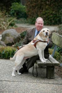 Michael Hingson with his guide dog Roselle, who helped Hingson lead his co-workers out of Tower One on Sept. 11.