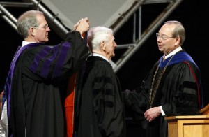 Doug Blaze, left, dean of the College of law, bestows an honorary Doctorate of Law hood on John Seigenthaler while Chancellor Jimmy G. Cheek looks on.