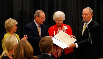 From left to right, Honey Alexander, Jimmy G. Cheek, Natalie Haslam and Lamar Alexander during the presentation of the original sheet music.