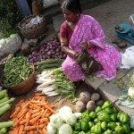 A vendor selling fresh vegetables