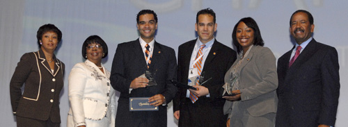 Students from UT Knoxville receive their second-place award during the National Black MBA Association Case Competition, sponsored by the Chrysler Foundation, Chrysler LLC and Chrysler Financial. Pictured, left to right, are Kim Harris Jones, senior vice president, corporate controller and auditor, Chrysler LLC; Barbara Thomas, president and CEO, National Black MBA Association; UT students James Walker, Martin Vargas and Alicia Cottrell; Frank Fountain, senior vice president, external affairs and public policy and president, Chrysler Foundation.