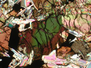 Thin slice of lunar basalt with a petrographic (geologic) microscope. This is the same view with crossed polarizers, revealing the complicated chemistry of the lunar minerals.