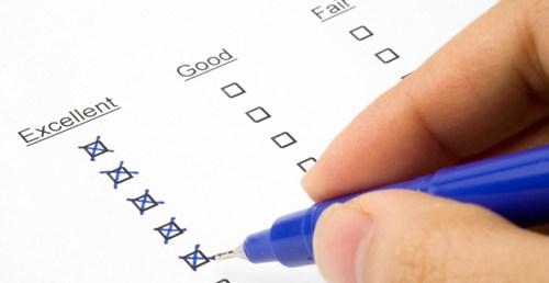 blue pen filling out a survey