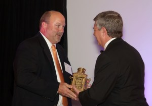 """Bill Hardman, right, president and CEO of the Southeast Tourism Society, presents Steve Morse the Southeast Tourism Society's """"Chairman of the Board"""" Shining Example Award"""