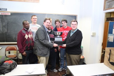 UT Institute for Nuclear Security Director Howard Hall (right) presents the Uranium Bowl trophy to NCSU Professor Steve Skutnik and the NCSU team.
