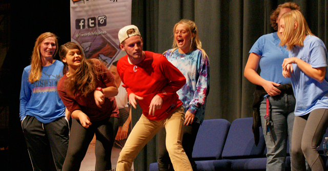 """Hypnotized students performing their """"Velociraptor dance"""" on a show by Chris Jones"""