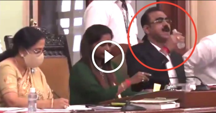 Viral video : Assistant Commissioner of BMC drank sanitizer considering water