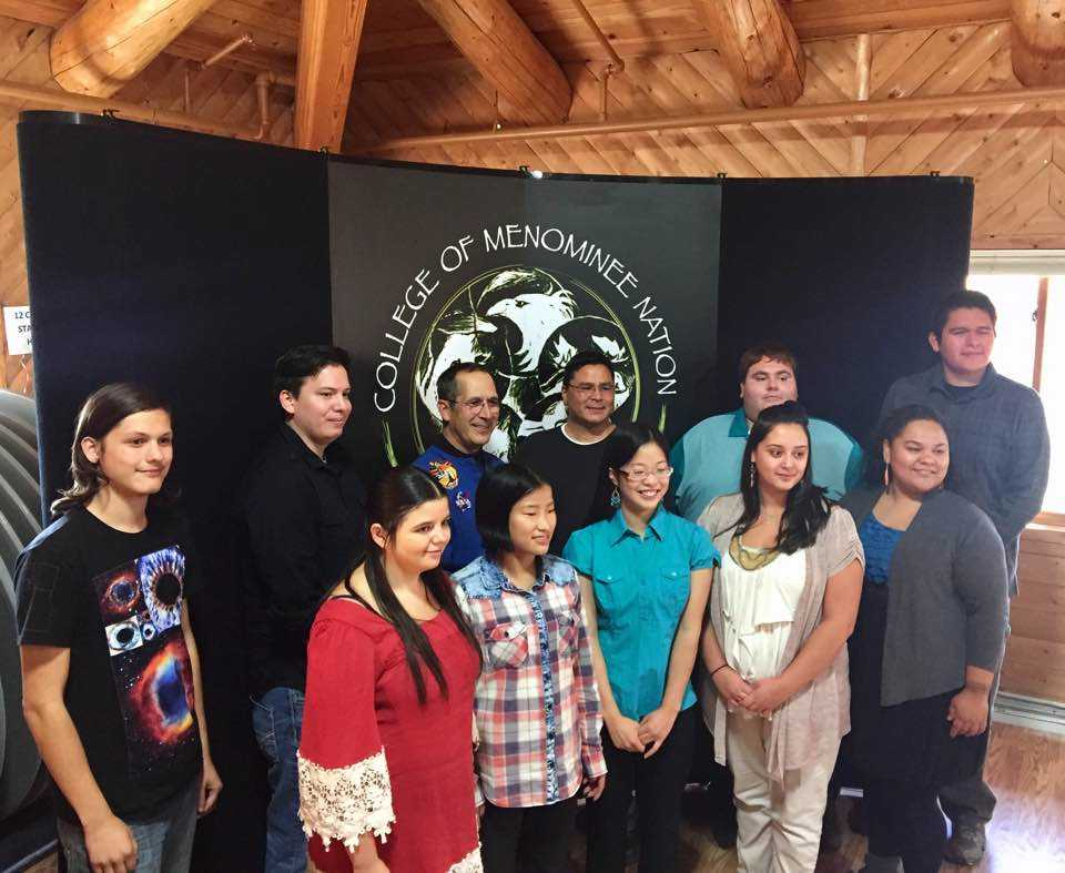 The National Science Foundation grant supported an event that brought John Herrington, the first enrolled Native American (Chickasaw) to fly in space, to CMN and UW–Madison over a three-day visit. Herrington (back row, third from left) met with students and shared his inspirational journey from childhood to his eventual career at NASA and the mission to the International Space Station.