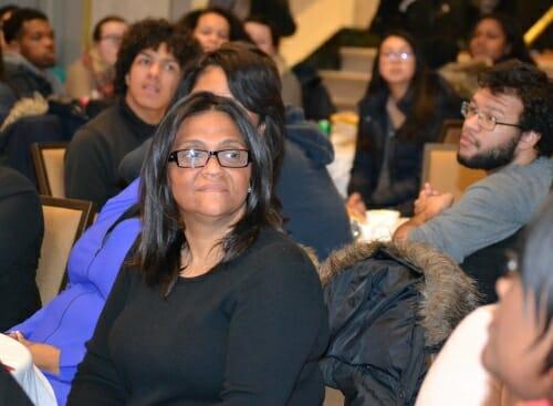Photo: Elizabeth Santiago sitting in crowd