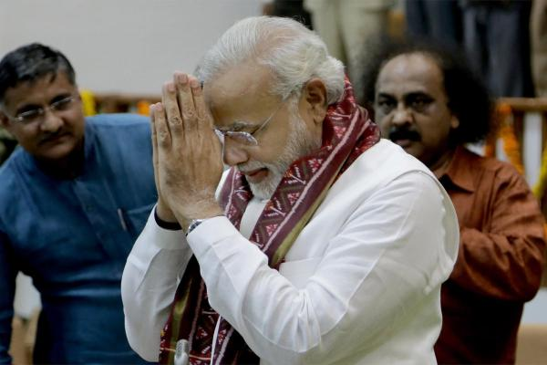 BJP parliamentary party leader and Gujarat Chief Minister Narendra Modi at the Gujarat Legislative Assembly in Gandhinagar ahead of resigning from his post of chief minister on May 21, 2014. (Photo: IANS)