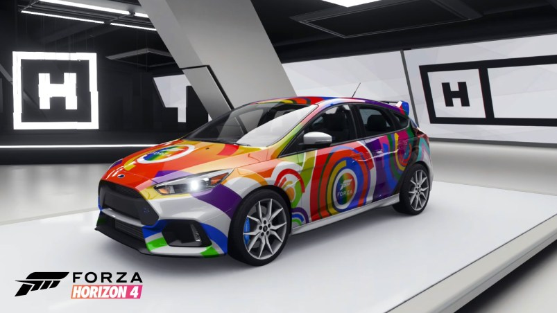The 2017 Ford Focus RS, decorated with a colorful rainbow circle pattern, is parked at an angle facing the viewer in Forza Horizon 4.