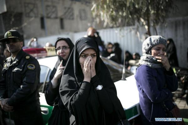 Iranians mourn 16 firefighters killed in Tehran building ...