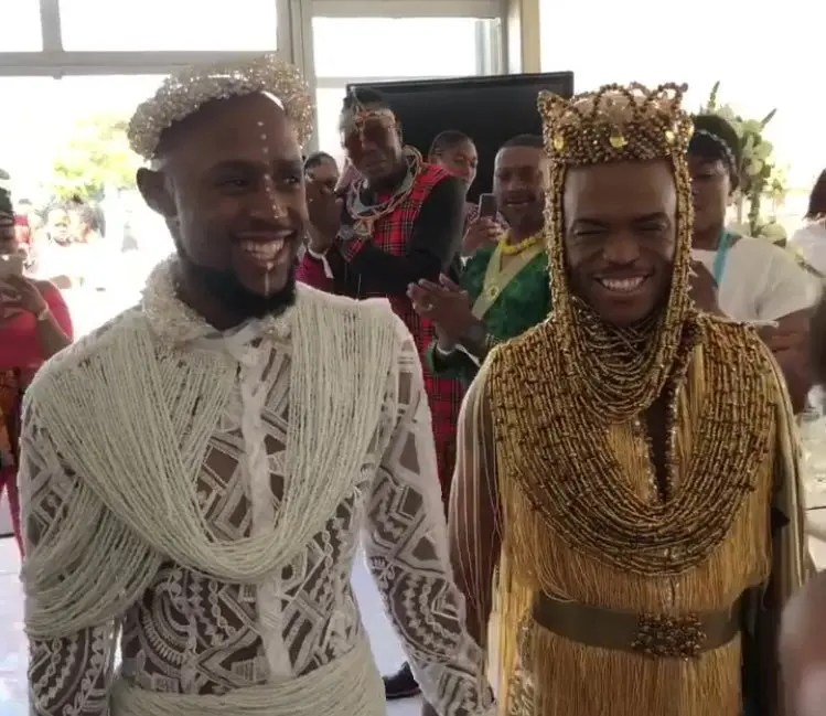 Somizi and Mohale walk in Wedding building
