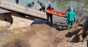 Excavator falls into dam