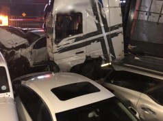 Truck crashes through car park