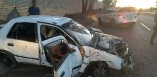 Three injured as car crashes through wall