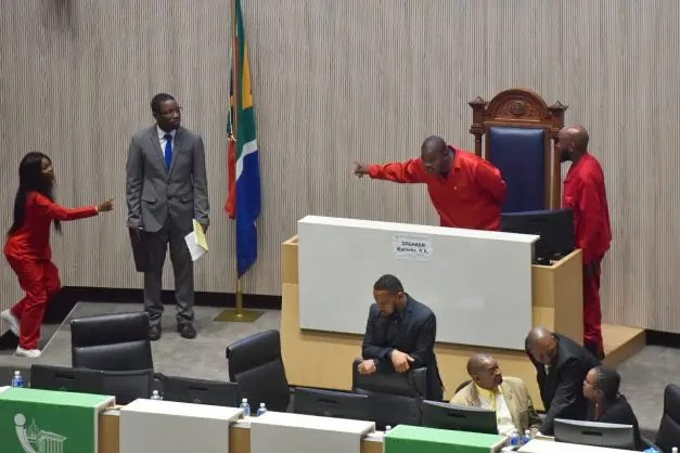 EFF councillors can be seen chasing away the Deputy Speaker, Zweli Khumalo during the Special Council sitting at Tshwane House