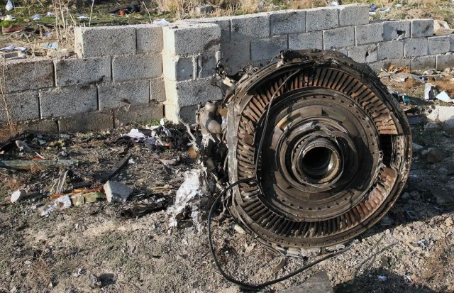 An engine lies on the ground after a Ukrainian plane carrying 176 passengers crashed near Imam Khomeini airport in the Iranian capital Tehran