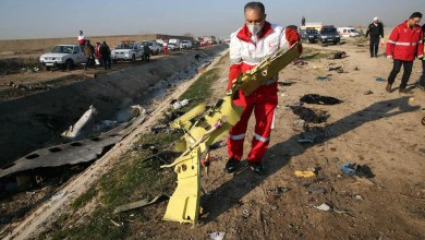 Rescue teams recover debris from a field after a Ukrainian plane carrying 176 passengers crashed near Imam Khomeini airport in the Iranian capital Tehran