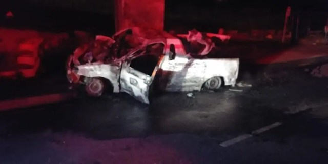 Driver injured after vehicle hits bridge pillar then bursts into flames