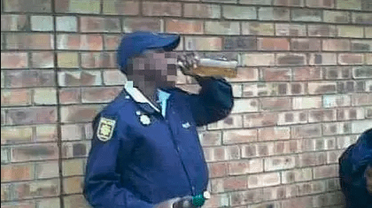 Police officer drinking beer