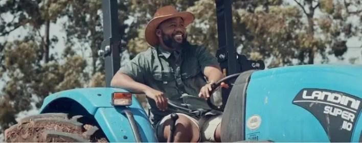 Cassper on a tractor