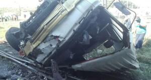 truck leaves bridge landing on railway tracks