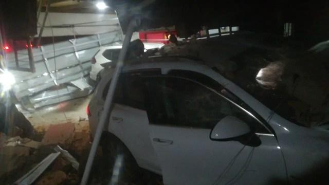 Driver injured after driving through garage wall