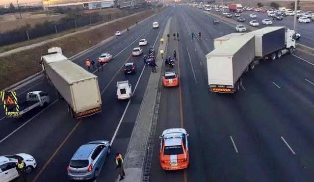 trucks block the road