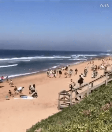 beachgoers run away from police