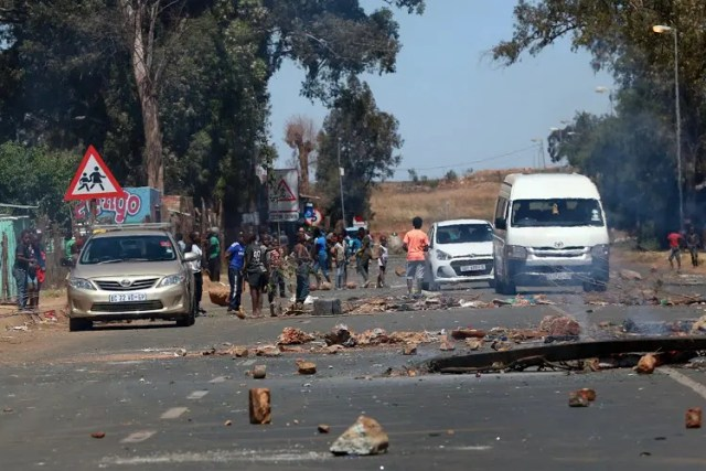 Shots fired as police and protesters clash over evictions