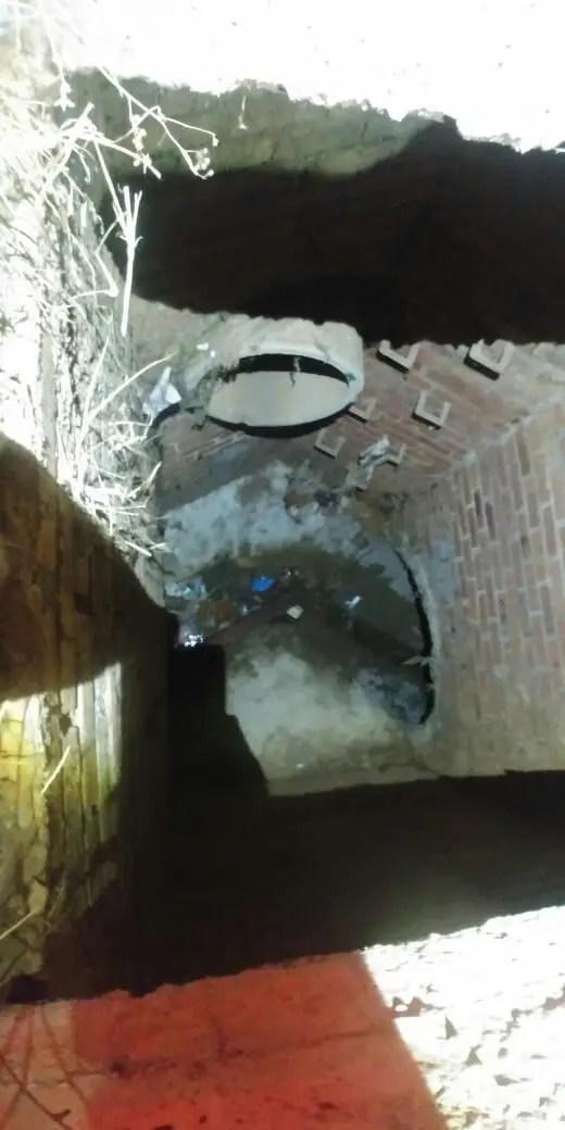 man falls into drain